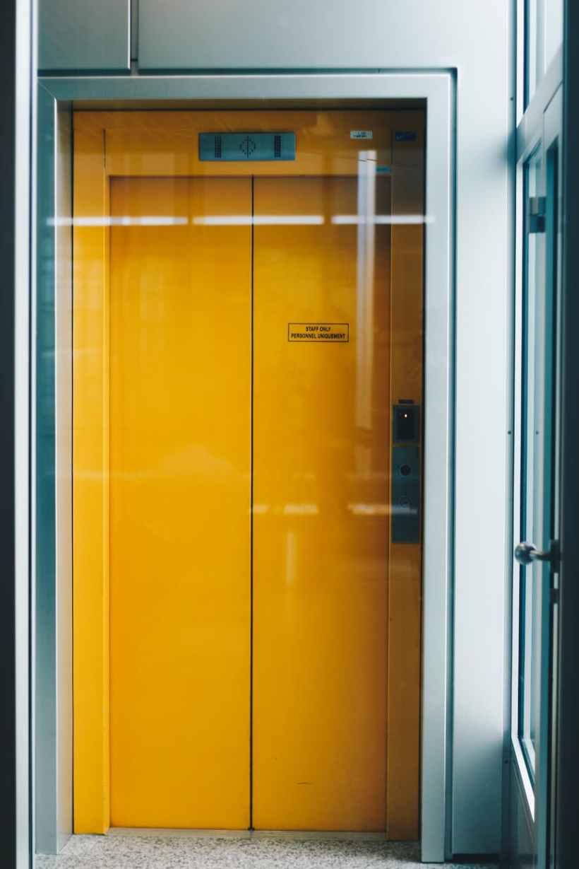 closed yellow elevator door