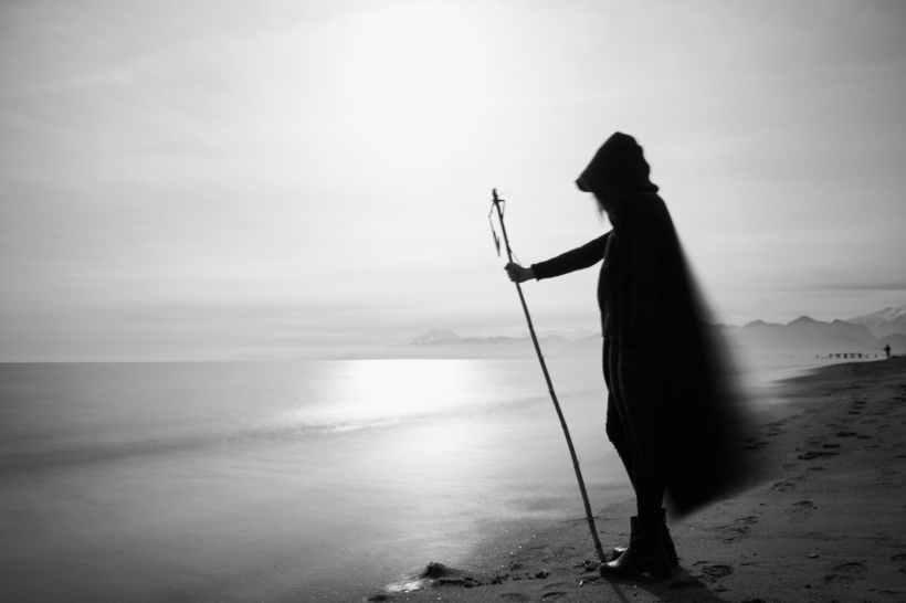 silhouette of person standing near calm sea